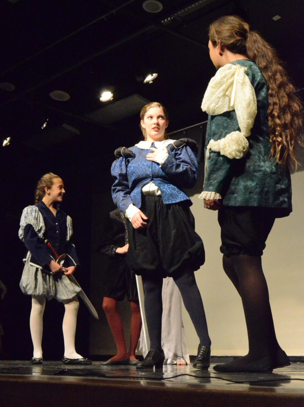 Maddie Eagan, center, as King Alonso discussing matters with her advisor Gonzolo (Katie Tuinei) shortly after thwarting a new dastardly scheme from Sebastian (Sophia Luke) and Antonio (Tristan Blanchard).
