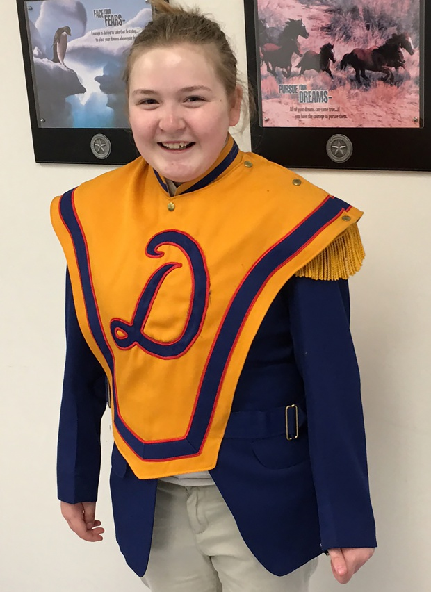 One of Dixon's current students displaying the old Dixon Marching Band regalia.