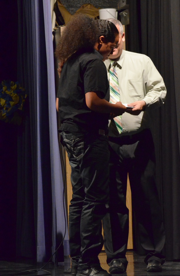 Sione Fungalei receives his Principal's Award from Mr. Sites.